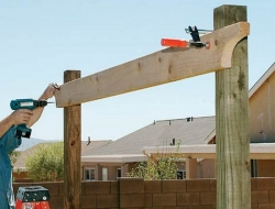 DIY Backyard Pergola - Attaching the Support Beams