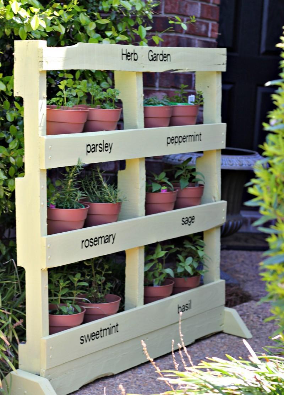 Diy pallet vertical herb garden the owner builder network for How to build a vertical pallet garden