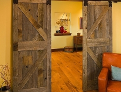Barn doors are great solution for partitioning off areas when you are space limited. Could you use one in your home?