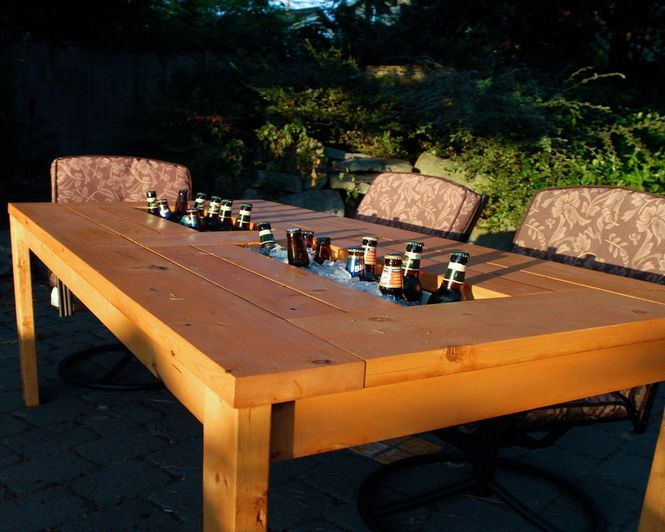 Patio table with built in beerwine coolers with liids for Table with cooler in middle