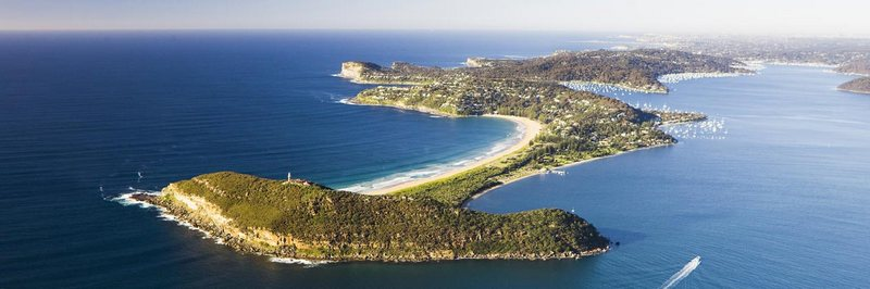 An aerial view over Barrenjoey Lighthouse and Palm Beach