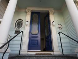 A deep blue front door creates an inviting entrance.
