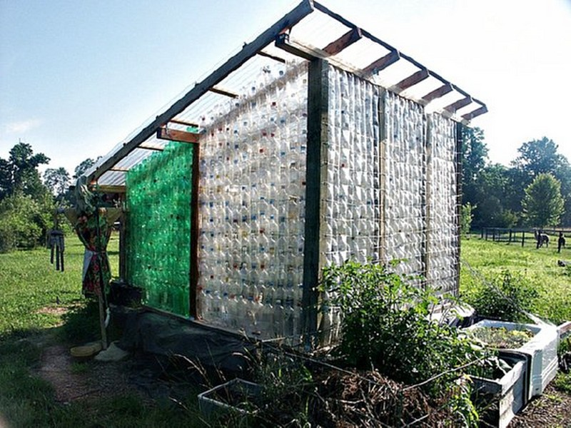 Repurposed plastic bottle greenhouses the owner builder network - Building a house with plastic bottles ...