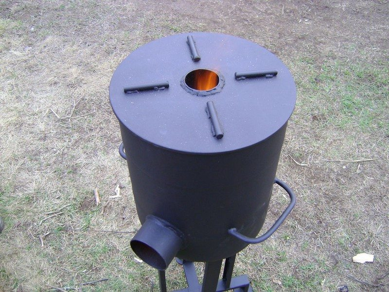 Homemade wood burning stoves and heaters the owner for Homemade rocket stove plans