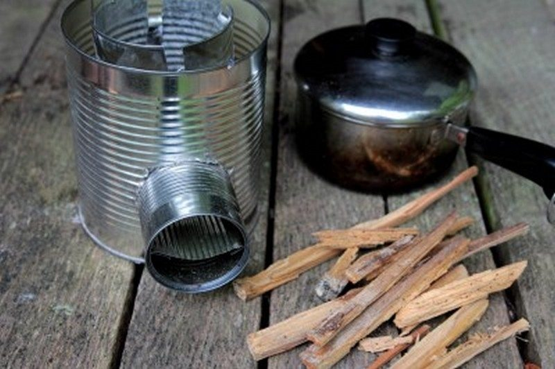 Homemade wood burning stoves and heaters the owner for Tin can rocket stove