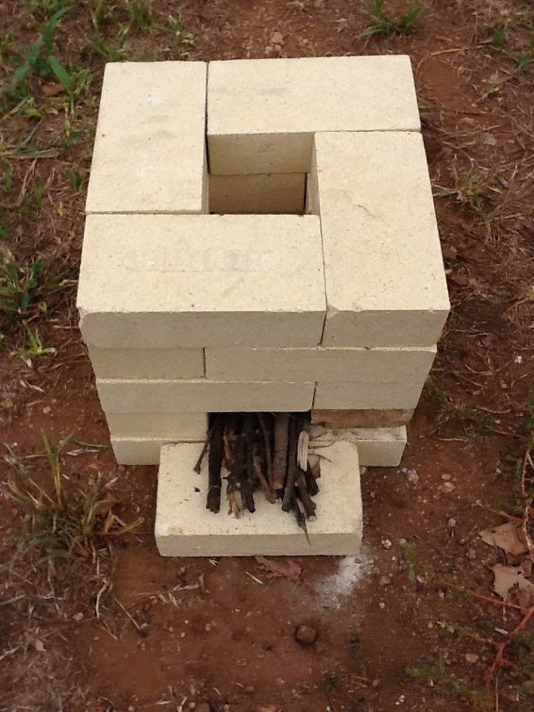 How to make a 6 brick rocket stove the owner builder for Brick rocket stove plans