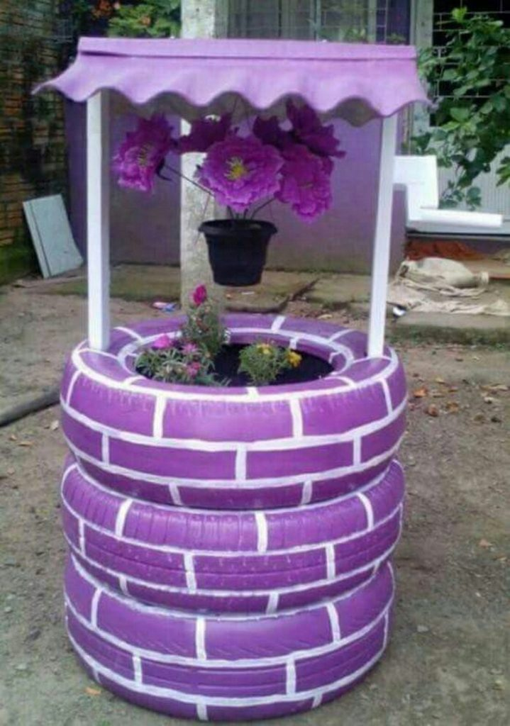 Wishing well planter made from recycled tires the owner for How to make a tire garden