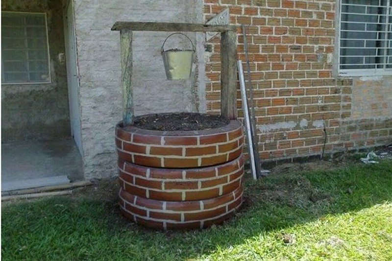 Wishing well planter made from recycled tires the owner for Puits decoration jardin