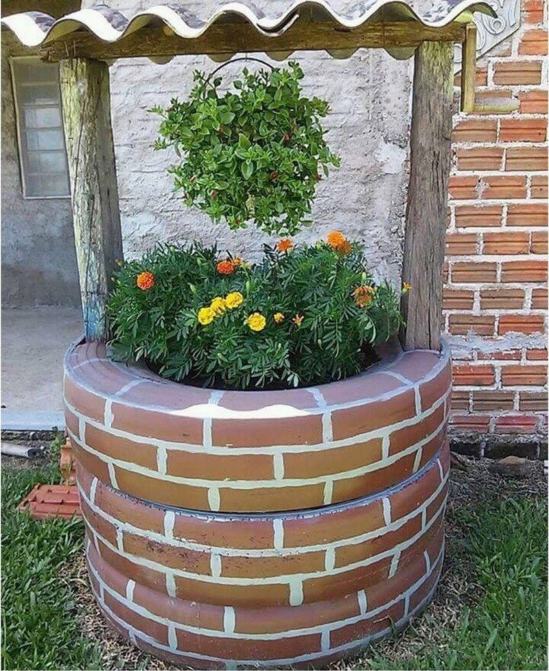Wishing well planter made from recycled tires the owner - Ideas para hacer un jardin ...
