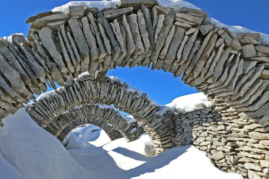 Sheep shelter in snow