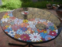 OK - someone has a lot of time and energy invested in this table. If you've ever tried mosaics, we think you'll agree this a great result. We'd be proud of it if it was our work...