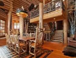 Whole tree furniture with a whole tree balustrade in a log cabin.  What do you think of the effect?