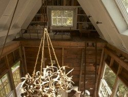 The view across to the first sleeping loft, and mini-library...