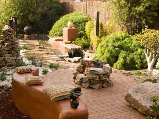 It's hard to go past this and not fall in love. Low maintenance with traces of a dry creek bed, a small water feature, and an outdoor fire. Not to mention the timber, rocks