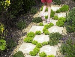 Even this simple path of concrete pavers can be made beautiful when planted out carefully.