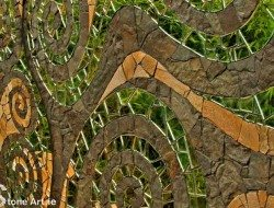This beautiful mosaic is the work of Irish craftsman Sunny Weiler of Stone Art. It hangs on a wall in a private garden.