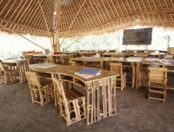 Learn naturally - 100% bamboo desks chairs and chalkboard - inside a Green School classroom