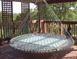 So, I'm seeing here an old trampoline base, some padding to cover the metal, either a custom canvas base or webbing created by rope weaving, and cushions... who is going to take the plunge and try this out? Maybe find an old trampoline at the local tip or recycling house?
