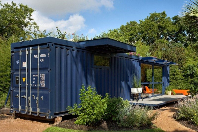 The original container doors provide access to garden shed.