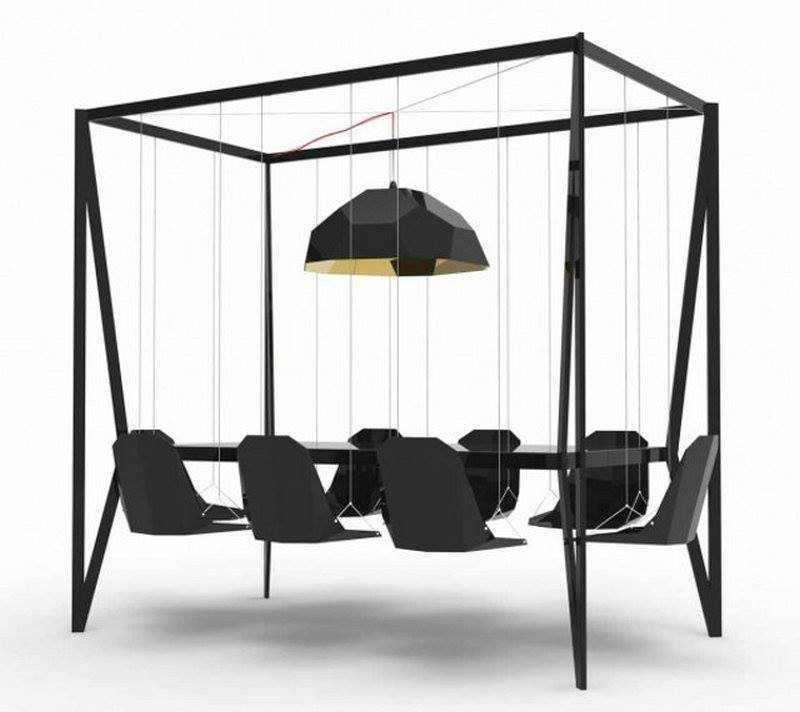Sweeping under this Swing Table by Duffy London might be easy, but what do you think about eating at it, or using it as a conference table?