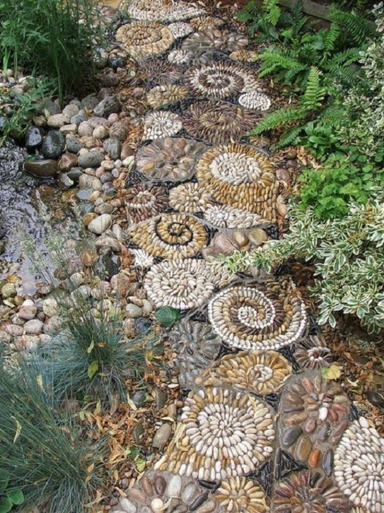 Here's another earthy toned mosaic garden path. All it takes is time and a little imagination.