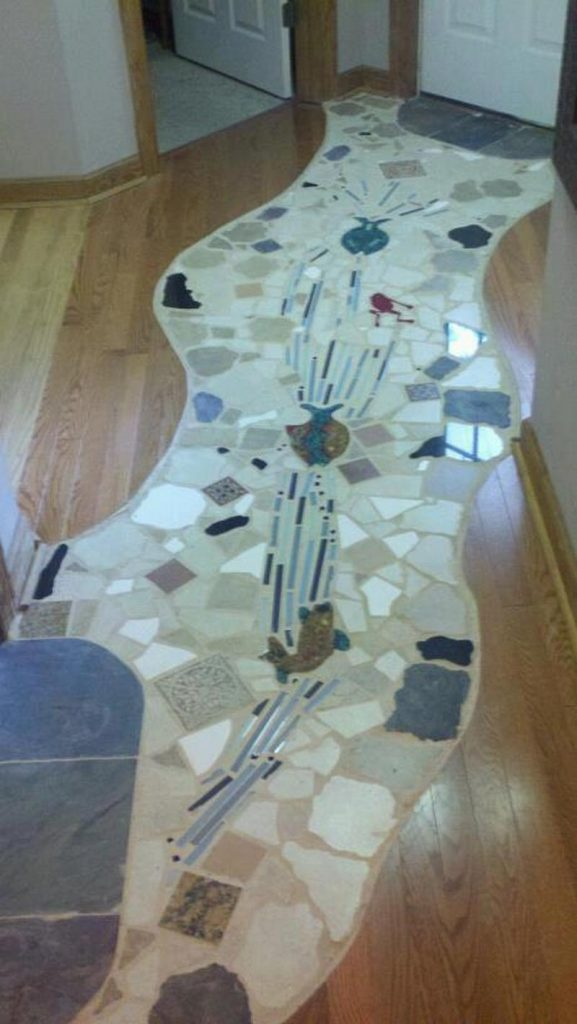 One of our fans - Clark Swindell - shared the mosaic he has installed in his renovated kitchen.  We think it's great.