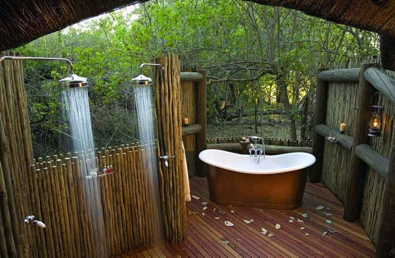 A gorgeous outdoor bathroom, with the addition of a lush bathtub, and the necessary wilderness view.