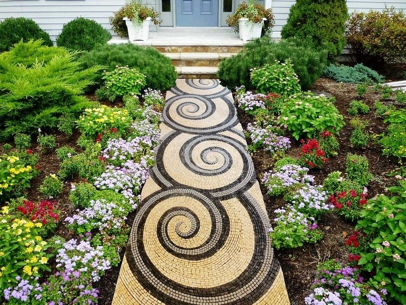 Here's another interesting example of a mosaic garden path. Mosaics are a great DIY project for those with patience.