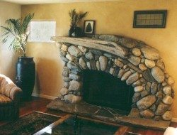 Driftwood and stone fireplace