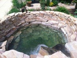 The same well finished and full of crystal clear water