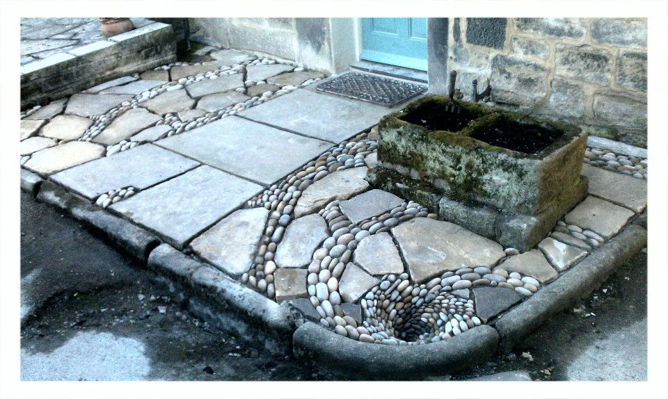 'The patio that flows down the drain' Yorkshire stone flagstones, cobbles finishing with a pebble mosaic whirlpool working drain