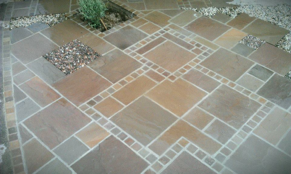 Indian sandstone paving with inset pebble mosaic 'thinking outside the box'