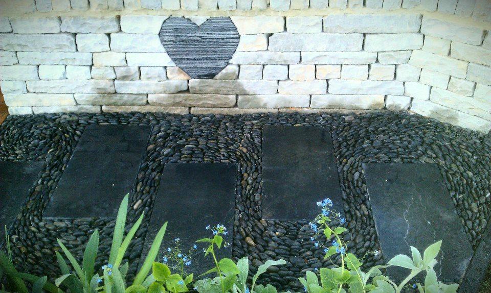 slate heart sculpture, roof slate heart (gold award winning show garden at the 2012 Harrogate Spring flower show) — at Harrogate Flower Show.