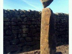 Stone balancing, 3 through stones from a drystone wall