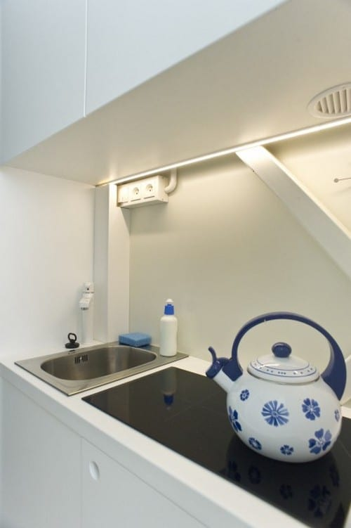 A fully functional kitchen in a hallway