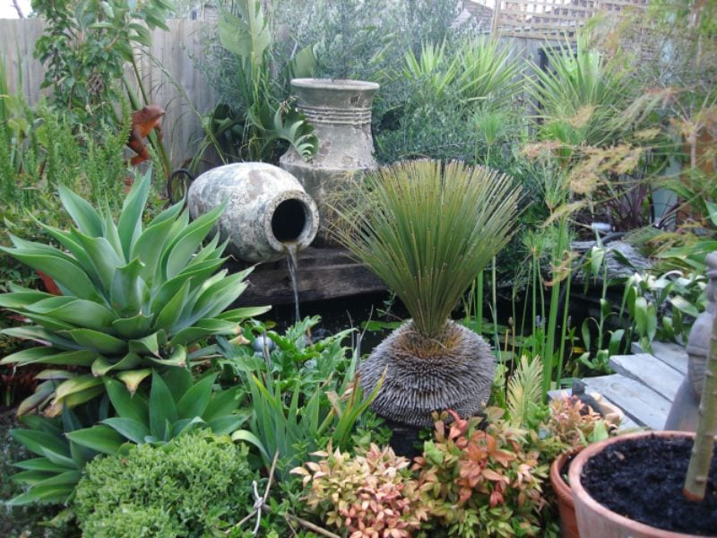 We have been very remiss in not showing any water features lately.  Here is a lovely example to get the ball rolling.  Remember, if the water is moving, mosquitoes cannot breed. Otherwise, put in a few goldfish to eat the larvae.