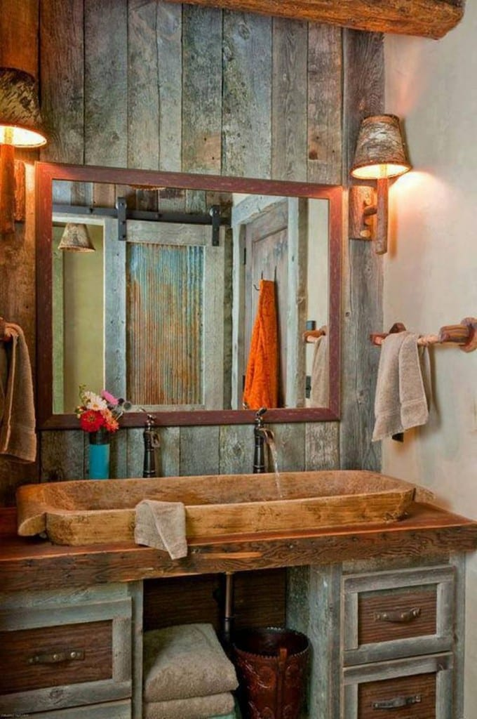 We can't make up our minds on this bathroom. Judging by the reflected view in the mirror, the theme is consistent with the house.  Too primitive, not primitive enough or absolutely perfect? It's your call!