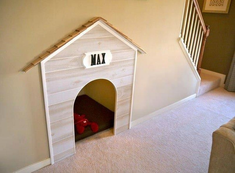 Just what any pampered pooch deserves - their very own den under the stairs.  Better still, make it big enough for your partner to sleep in when