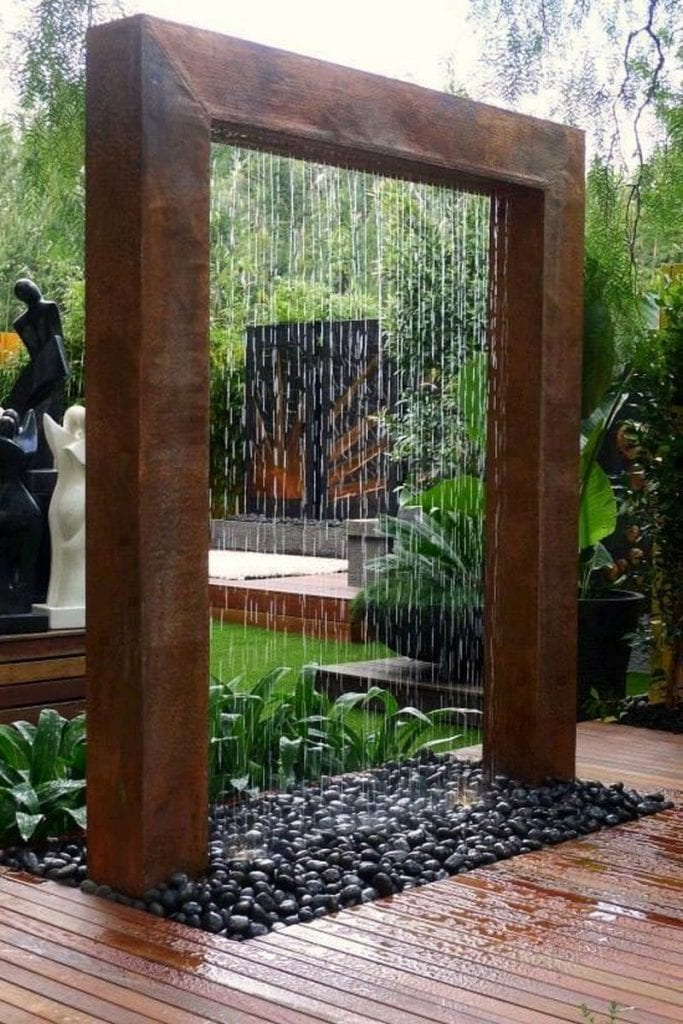 Is it a water feature, an outdoor shower or some combination of both? No matter what it is, I think it would be refreshing on a hot day.