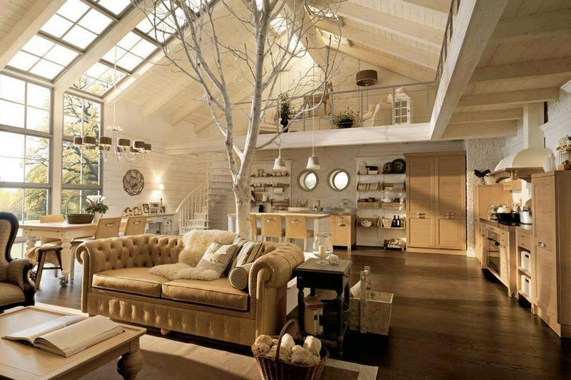 What a light and bright space this great room is.  I wonder how the tree fits into the design?