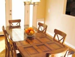 Need a dining table? All you need is an old door, table legs, and a glass to go on top of it.
