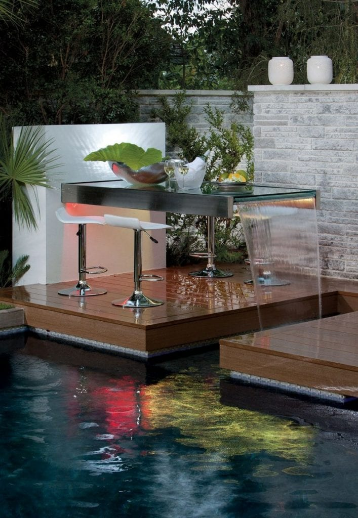 My gut feeling on this set up is that it is there for decoration.  The water feature would probably be too noisy to hold a conversation and after a few wines, it could be treacherous to get to.  What do you think?