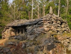 Somewhere in Sjolanda Sweden you'll come across this stone cottage built by hand by the owner from stones gathered whilst walking in the forest.