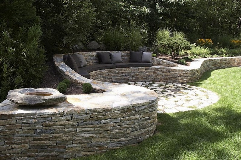 We haven't given you any dry stone wall ideas for ages.   Here's one we think is worth sharing. It's a great example of a retaining wall that does NOT interfere with the natural site drainage, and has a seat and cushions too!  Love it or hate it? Let us know what you think in the comments section.