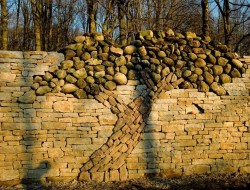 Here's a stunning dry stone wall by Eric Landman. It's in a conservation area in Orangeville, Ontario, as a memorial to his late wife Kerry Landman.