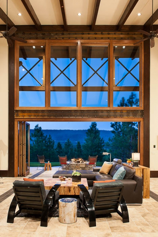 As a unique feature of the great room window wall, doors were included in the design so that they could fold back and away to create an uninterrupted flow indoors and out