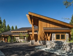 The side-view of this home shows the multiple roof-planes and angled pitches showcasing its new age design