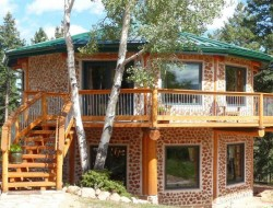 Cordwood masonry, cordwood construction, stackwall, log-end, stovewood or stackwood.