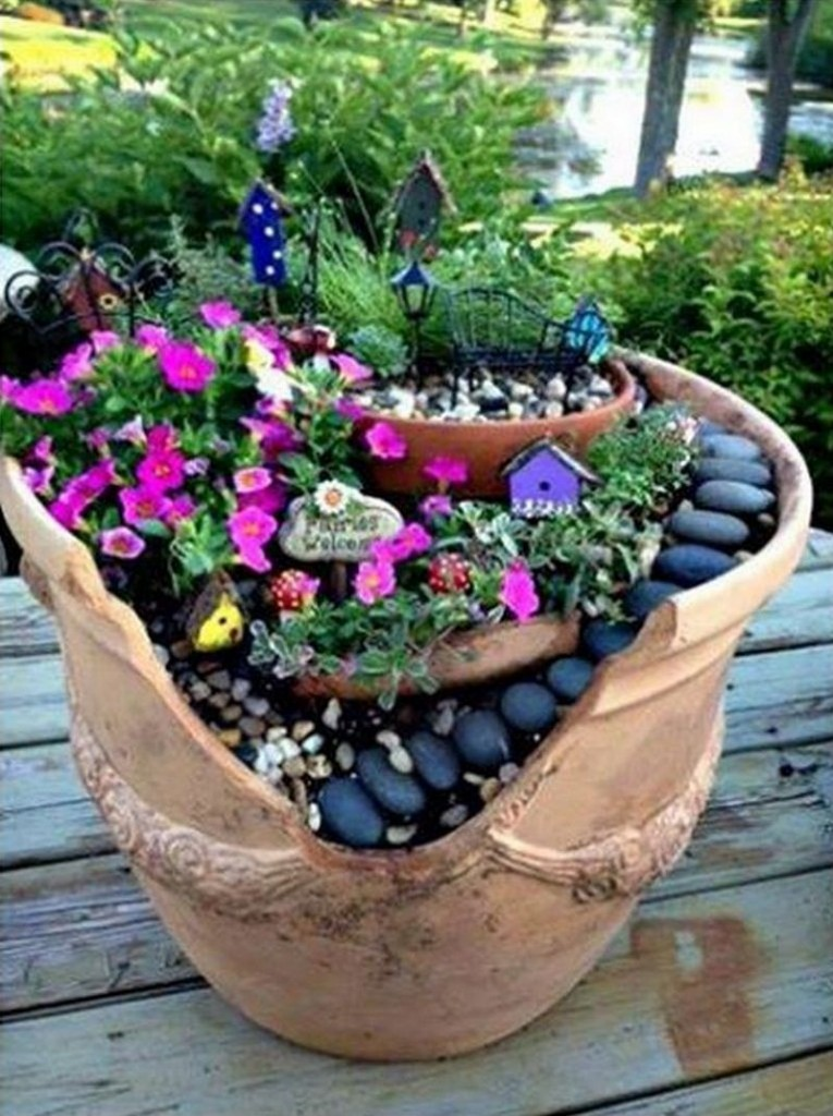 You know all those broken terracotta pots you've thrown away? They could have been transformed into a fairy garden for the kids.