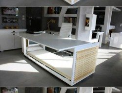 This is one way to get more space... a desk with bed by Studio NL